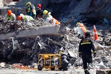 Body recovery workers carefully comb the rubble of the CTV building. Photo / Sarah Ivey