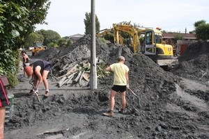 Cleaning up in Christchurch's eastern suburbs. Photo / Geoff Sloan