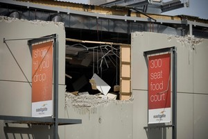 Eastgate Mall was left with holes in the outside walls and shops exposed after the earthquake. Photo / Dean Purcell