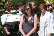 A close friend carries the coffin of Baxtor Gowland at yesterday's funeral. Photo / Greg Bowker