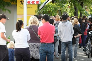 People queue outside Work and Income on Riccarton Rd in Christchurch. Photo / Greg Bowker