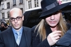Fashion designer John Galliano, right, arrives with his lawyer at a police station in Paris. Photo / AP
