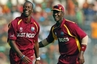 West Indies's bowler Kemar Roach,(L), celebrates with captain Darren Sammy, after dismissing Bangladesh's batsman Mohammad Ashraful. Photo / Getty Images