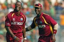 West Indies's bowler Kemar Roach,(L), celebrates with captain Darren Sammy, after dismissing Bangladesh's batsman Mohammad Ashraful. Photo / Getty Images