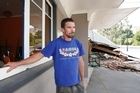 Cafe owner Justin Good at his earthquake damaged cafe in Heathcote Valley. Photo / Brett Phibbs
