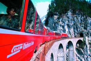Trundling past stunning views on Swiss Rail. Photo / Supplied