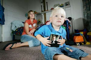 Juliet Sheppard, wife of missing man Lee Sheppard and their son Jaden. Photo / Chris Skelton