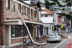 Wrecked buildings line the streets of Lyttelton  Photo / Sarah Ivey