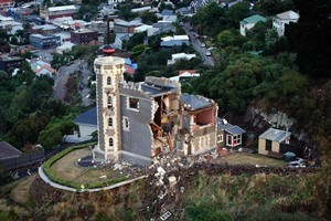 The wrecked Timeball Station on the hill above Lyttelton township. Photo / Sarah Ivey