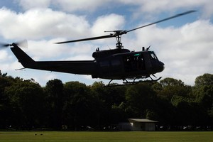 An Air Force Iroquois helicopter lands in South Hagley Park in Christchurch this afternoon. Photo / Sarah Ivey