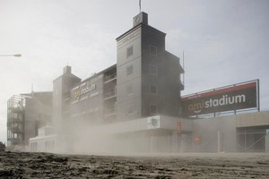 A dust bowl forms around AMI Stadium following a 6.3-magnitude earthquake that hit Christchurch causing major damage and fatalities. Photo / Dean Purcell