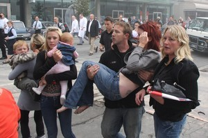 After falling five storeys in the wreckage of the CTV building, a crying Jett Mitchell, his sister Dita and his mother Kendyll Mitchell were carried to safety by passers-by. Photo / Geoff Sloan