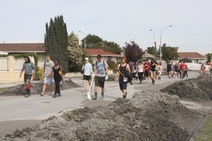 The Student Army on the march in Avondale. Photo / Geoff Sloan