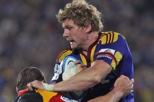 Adam Thomson stole no less than six clean turnovers for the Highlanders against the Chiefs. Photo / Getty Images