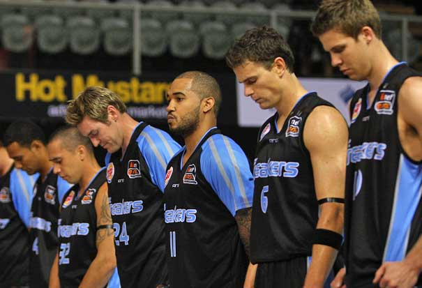 The Breakers line up for one minutes silence acknowledging the Christchurch earthquake before their round 20 NBL against the Gold Coast Blaze. Photo / Getty Images
