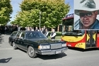 Red Bus employees form a guard of honour for the hearse as it leaves after the funeral of Andrew Craig, inset, this afternoon. Photos / Sarah Ivey, Supplied