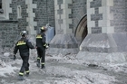 Members of the New Zealand Urban Search and Rescue Team examine Christchurch Cathedral. Photo / Getty Images