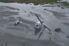 The Palmerston North Rescue Helicopter was tasked to Hokio Beach, north of Paraparaumu, this morning where a commercial Huey had crashed onto the beach. Photo / Palmerston North Rescue Helicopter