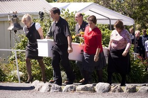 Members of Shane Tomlin's family bring out his coffin after a service at the St Paul's on the Hill Church in Kaikoura. Photo / Dean Purcell