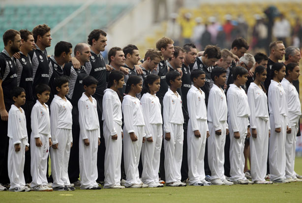 Members of New Zealand's cricket team stand in silence to pay respects to the Christchurch earthquake victims before the start of their Cricket World Cup match against Australia in Nagpur. Photo / AP
