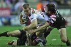Ben Creagh of St George Illawarra Dragons is tackled by Martin Gleeson of Wigan Warriors during the World Club Challenge. Photo / Getty Images