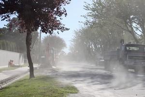 Dust swirling in the wind on a street in Avonside. Photo / Paul Harper