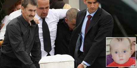 Grant Smith (centre), the father of eight-month-old earthquake victim Jayden Harris, follows his son's casket after his funeral today. Jayden Harris (inset). Photos / Getty Images, Mark Mitchell
