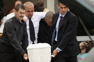 Grant Smith (centre), the father of eight-month-old earthquake victim Jayden Harris, follows his son's casket after his funeral today. Photo / Getty Images