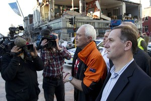 Prime minister John Key (R) and mayor Bob Parker survey damage in the Christchurch CBD. Photo / Simon Baker