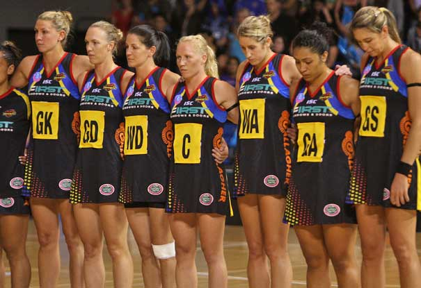 The Magic team stand for one minutes silence for the Christchurch earthquake before their round three ANZ Championship match against the Northern Mystics. Photo / Getty Images