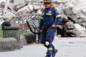 An emergency worker outside Christchurch Cathedral. Photo / Doug Sherring