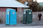 Portable toilets stand in the Christchurch suburbs. Photo / Doug Sherring