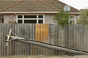 A fallen power pole in the suburb of Burwood. Photo / Getty Images