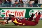 Kieron Pollard  takes a diving catch in the outfield to dismiss Kevin O'Brien of Ireland. Photo / Getty Images