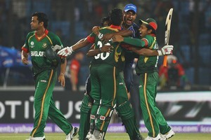 Mahmudullah of Bangladesh is congratulated by his team mates, after hitting the winning runs against England. Photo / Getty Images