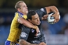 Feleti Mateo of the Warriors is tackled by Jeff Robson of the Eels. Photo / Getty Images