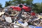A car on top of a pile of rubbish on Bealey Ave in Christchurch. Photo / Geoff Sloan