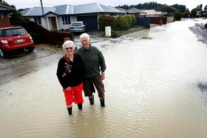 Jan and Marty Westerink's Parklands street is back under water again after overnight rain. Photo / Sarah Ivey