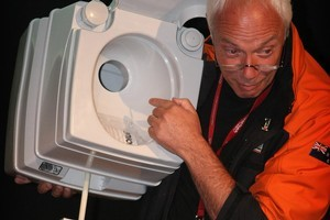 Christchurch Mayor Bob Paker demonstrates how one of the portable toilets works. Photo / Greg Bowker