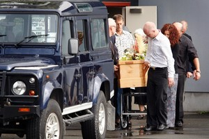Pallbearers carry the casket of Owen Wright into his Land Rover after the funeral today. Photo / Sarah Ivey