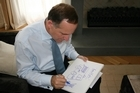 Prime Minister John Key draws a doodle to be sold on Trade Me to raise funds for Christchurch earthquake relief. Photo / Supplied