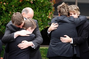 Family comfort one another after the funeral of Dr Dominic Bell. Photo / Sarah Ivey