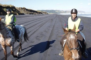 Muriwai Beach is one of the prime spots in Auckland to go horse riding. Photo / Supplied