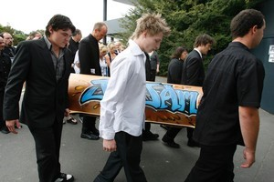 Jaime Gilbert's coffin is carried into his funeral at Burnside. Photo / Brett Phibbs