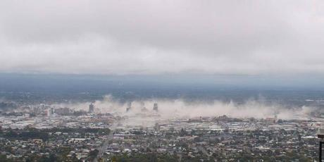 Dust cloud over Christchurch City, moments after the 6.3 magnitude earthquake struck. Photo / Supplied