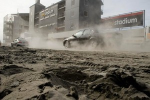 A dust bowl forms around AMI Stadium following the devastating Christchurch earthquake. Photo / Dean Purcell