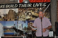 Peter Montgomery spurred on auction guests to donate.  Photo / Ellie Brade