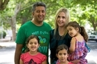 Anil and Rachel Sharma with their girls, Cate, Lauren and Jessica in Franklin Rd. Photo / Paul Estcourt