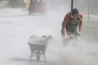 Cleaning up silt in Christchurch after the earthquake. Photo / Mark Mitchell