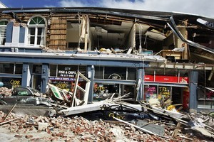 Damaged shops in Manchester Street. Photo / Getty Images